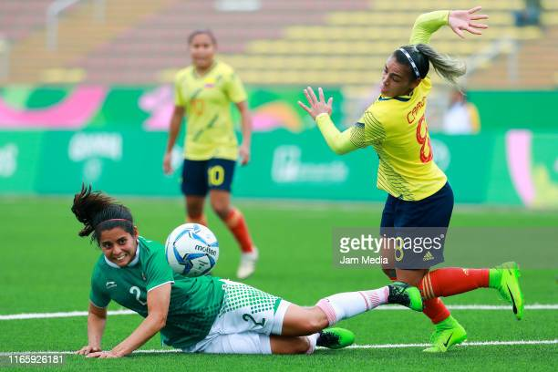 Kenti Robles of Mexico fights for the ball with Jessica Caro of Colombia during Women's First Round Group A match between Mexico and Colombia at San...