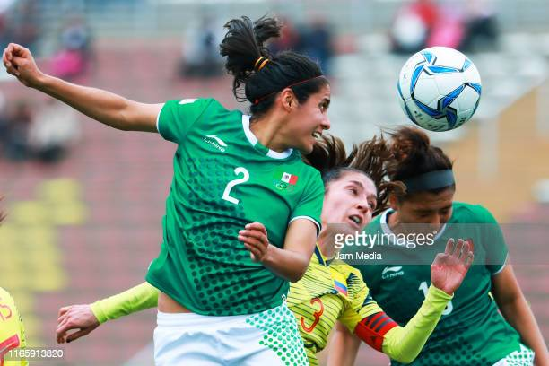 Kenti Robles of Mexico fights for the ball with Natalia Gaitan of Colombia during Women's First Round Group A match between Mexico and Colombia at...