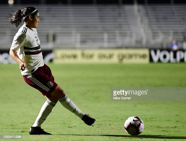 Kenti Robles of Mexico passes the ball against Trinidad and Tobago during the soccer game at WakeMed Soccer Park on October 7 2018 in Cary North...