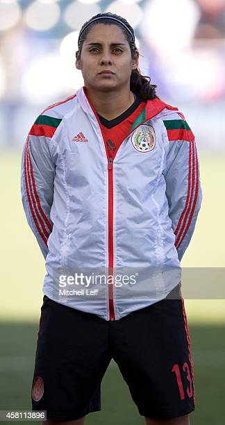 Kenti Robles of Mexico stands for the countries anthems prior to the game against Trinidad Tobago in the 2014 CONCACAF Women's Championship third...