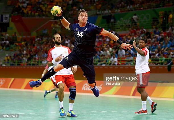 Kentin Mahe of France jumps to take a shot during the Men's Preliminary Group A match between France and Denmark on Day 10 of the Rio 2016 Olympic...