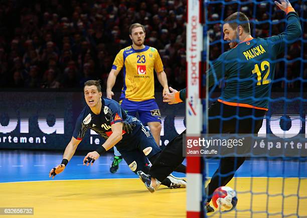 Kentin Mahe of France scores a goal against goalkeeper of Sweden Andreas Palicka during the 25th IHF Men's World Championship 2017 Quarter Final...