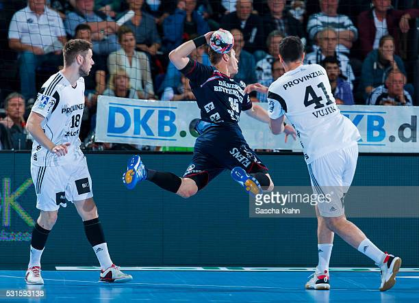 Kentin Mahe of SG FlensburgHandewitt challenges Niclas Ekberg and Marko Vujin of THW Kiel during the DKB HandballBundesliga match at SparkassenArena...
