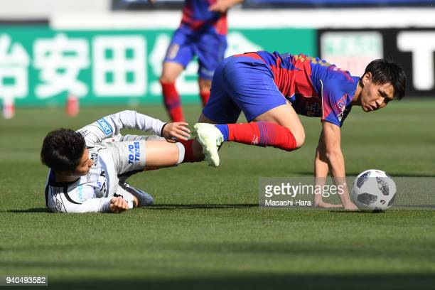 Kento Hashimoto of FC Tokyo and Haruya Ide of Gamba Osaka compete for the ball during the J.League J1 match between FC Tokyo and Gamba Osaka at...
