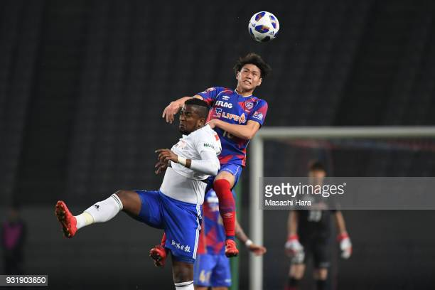 Kento Hashimoto of FC Tokyo and Thalles of Albirex Niigata compete for the ball during the JLeague YBC Levain Cup Group A match between FC Tokyo and...