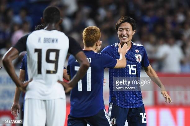 Kento Misao and Takuma Asano of Japan celebrate during the international friendly match between Japan and Costa Rica at Suita City Football Stadium...