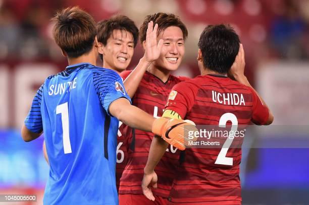 Kento Misao celebrates victory with Atsuto Uchida of Kashima Antlers during the AFC Champions League semi final first leg match between Kashima...