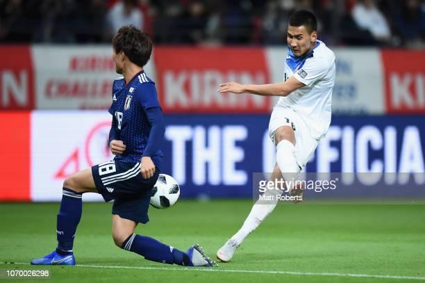 Kento Misao of Japan blocks a shot at goal by Kairat Zhyrgalbek Uulu of Kyrgyz Republic during the international friendly match bewteen Japan and...