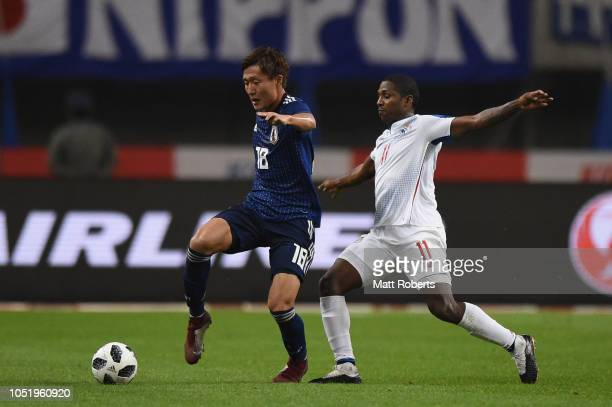 Kento Misao of Japan competes for the ball against Armando Cooper of Panama during the international friendly match between Japan and Panama at Denka...