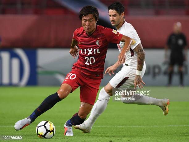 Kento Misao of Kashima Antlers and Alexandre Pato of Tianjin Quanjian compete for the ball during the AFC Champions League Round of 16 first leg...