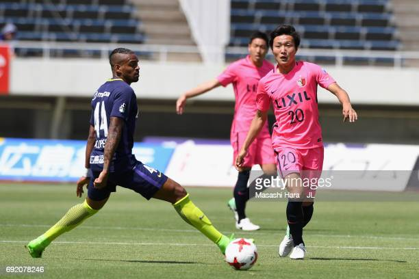 Kento Misao of Kashima Antlers and Anderson Lopes of Sanfrecce Hiroshima compete for the ball during the J.League J1 match between Sanfrecce...