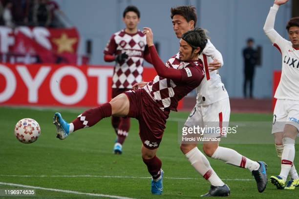 Kento Misao of Kashima Antlers and Hotaru Yamaguchi of Vissel Kobe compete for the ball during the 99th Emperor's Cup final between Vissel Kobe and...