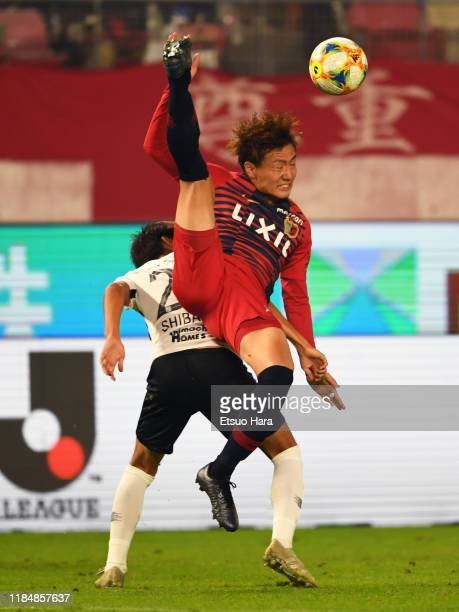 Kento Misao of Kashima Antlers and Kai Shibato of Urawa Red Diamonds compete for the ball during the J.League J1 match between Kashima Antlers and...