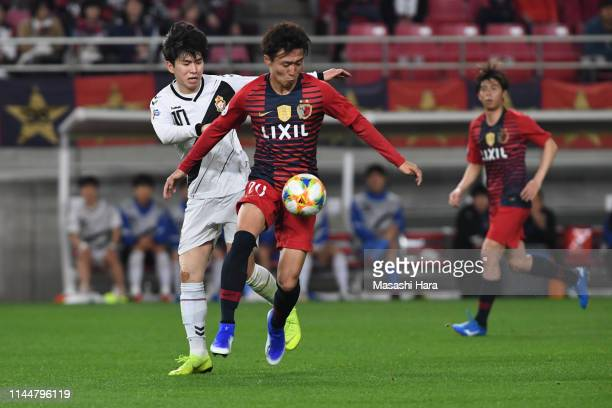 Kento Misao of Kashima Antlers and Kim Seungjun of Gyeongnam FC compete for the ball during the AFC Champions League Group E match between Kashima...