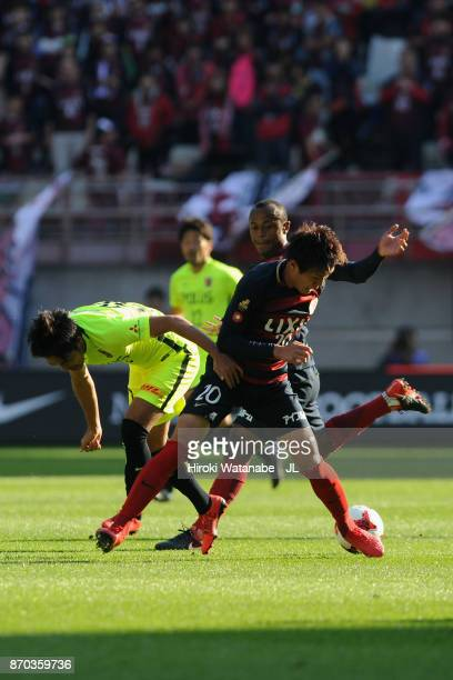 Kento Misao of Kashima Antlers and Shinzo Koroki of Urawa Red Diamonds compete for the ball during the J.League J1 match between Kashima Antlers and...