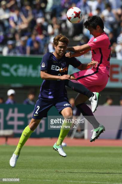 Kento Misao of Kashima Antlers and Yuki Nogami of Sanfrecce Hiroshima compete for the ball during the J.League J1 match between Sanfrecce Hiroshima...