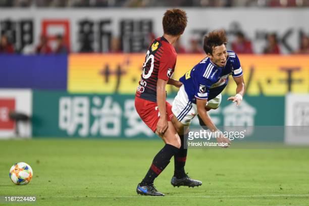 Kento Misao of Kashima Antlers and Yuki Otsu of Yokohama F.Marinos compete for the ball during the J.League J1 match between Kashima Antlers and...