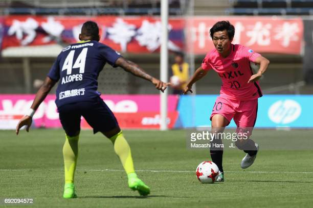 Kento Misao of Kashima Antlers takes on Anderson Lopes of Sanfrecce Hiroshima during the J.League J1 match between Sanfrecce Hiroshima and Kashima...