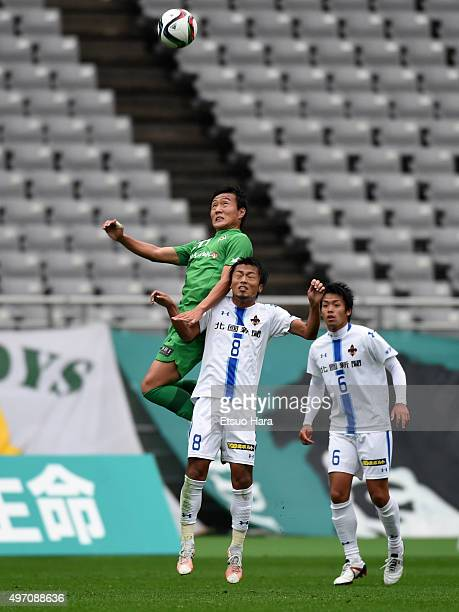Kento Misao of Tokyo Verdy and Kenta Yamafuji of Zweigen Kanazawa compete for the ball during the J.League second division match between Tokyo Verdy...