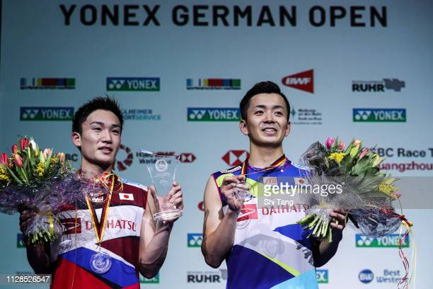 Kento Momota and Kenta Nishimoto of Japan pose with their trophies after the Men's Single final match during day six of the Yonex German Open on...