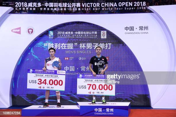 Kento Momota of Japan and Anthony Sinisuka Ginting of Indonesia pose with their trophies after the Men's Single final match on day six of the China...