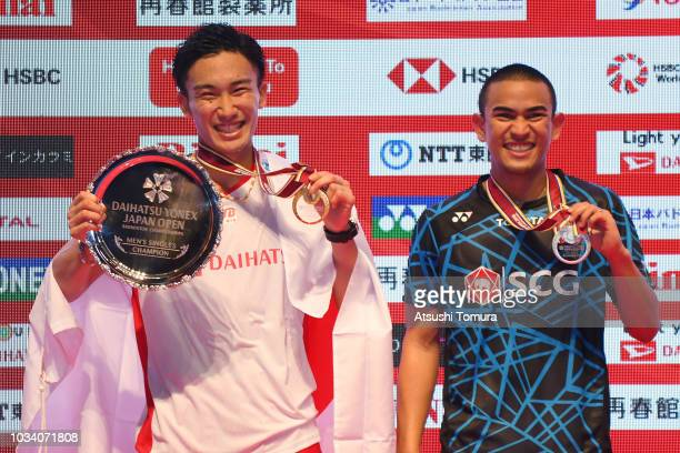 Kento Momota of Japan and Khosit Phetpradab of Thailand pose on the podium on day six of the Yonex Japan Open at Musashino Forest Sports Plaza on...