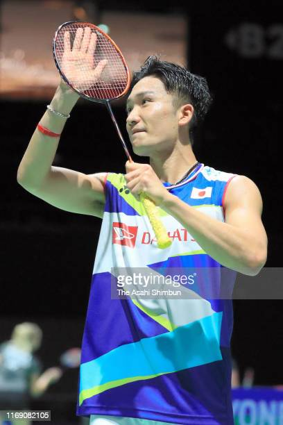 Kento Momota of Japan applauds fans after his victory in the Men's Singles first round match against Cao Cuong Pham of Vietnam during day one of the...