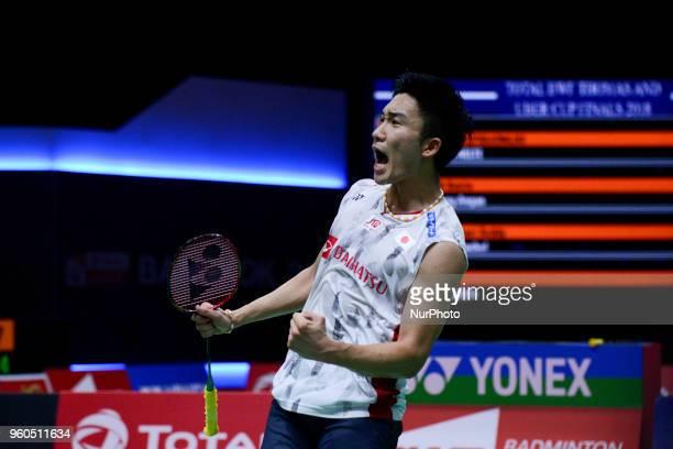 Kento Momota of Japan celebrate after defeating Ng Ka Long Angus of Hong Kong during their Thomas Cup Group C badminton match at the Thomas &...