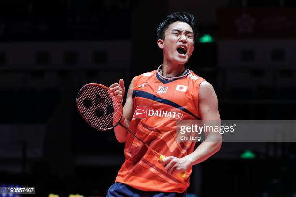 Kento Momota of Japan celebrate the victory in the Men's Singles round robin match against Anders Antonsen of Denmark during day two of the HSBC BWF...