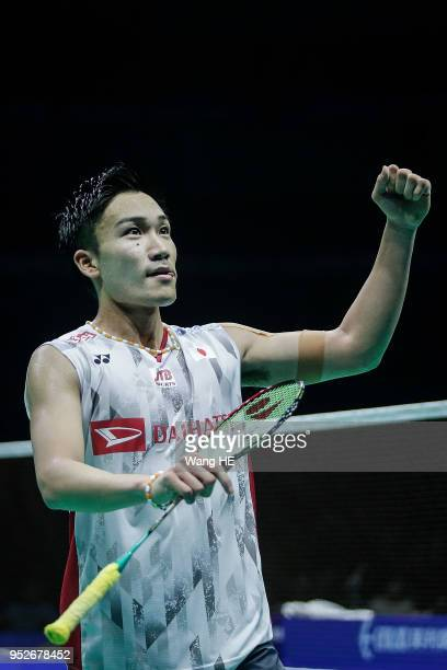 Kento Momota of Japan Celebrate wins point during man's singles final match against Chen long of China at the 2018 Badminton Asia Championships on...