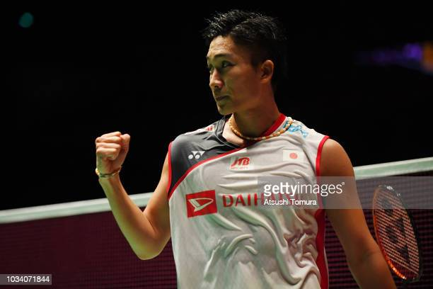 Kento Momota of Japan celebrates after winning the men's singles final match against Khosit Phetpradab of Thailand on day six of the Yonex Japan Open...