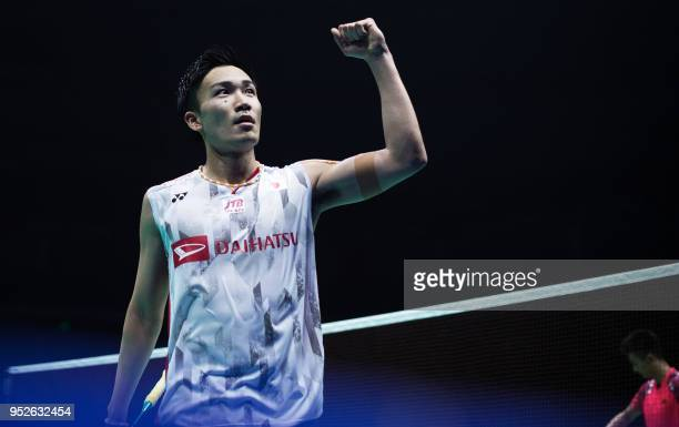 Kento Momota of Japan celebrates after winning the men's singles final match against Chen Long of China at the 2018 Badminton Asia Championships in...