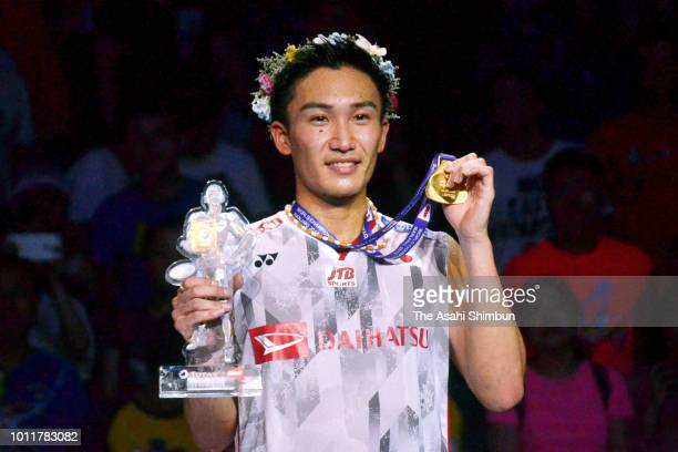 Kento Momota of Japan celebrates on the podium at the medal ceremony for the Men's Singles on day seven of the Total BWF World Championships at...