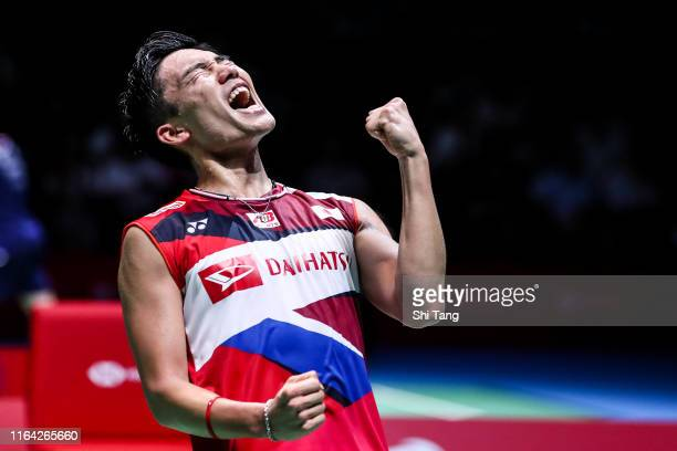 Kento Momota of Japan celebrates the victory in the Men's Singles quarter finals match against Anthony Sinisuka Ginting of Indonesia during day four...