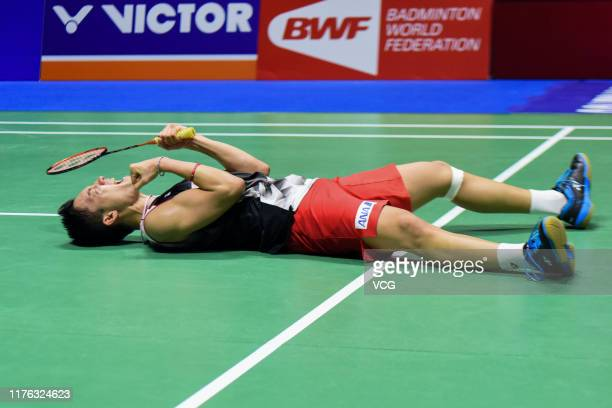 Kento Momota of Japan celebrates victory after the Men's Singles final match against Anthony Sinisuka Ginting of Indonesia on day six of 2019 China...