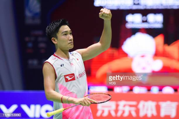Kento Momota of Japan celebrates victory after the Men's Singles semi-final match against Chen Long of China on day five of 2019 China Badminton Open...