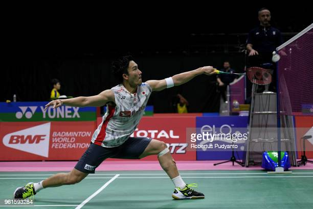 Kento Momota of Japan competes against Chou Tien Chen of Chinese Taipei during Preliminary Round on day four of the BWF Thomas Uber Cup at Impact...
