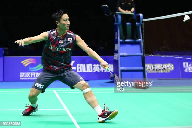 Kento Momota of Japan competes against Lee Chong Wei of Malaysia during men's singles semifinal match on day five of 2018 Badminton Asia...