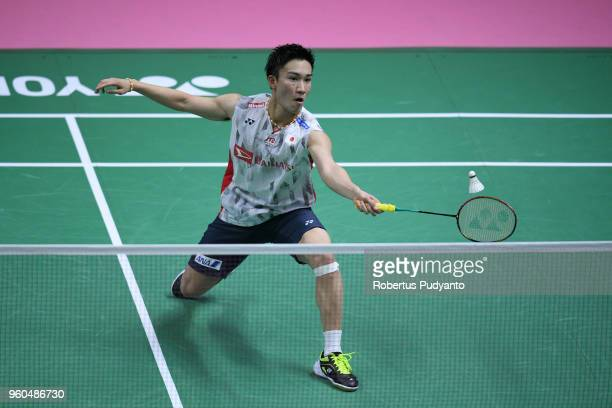 Kento Momota of Japan competes against Ng Ka Long Angus of Hong Kong during qualification match on day one of the BWF Thomas Uber Cup at Impact Arena...