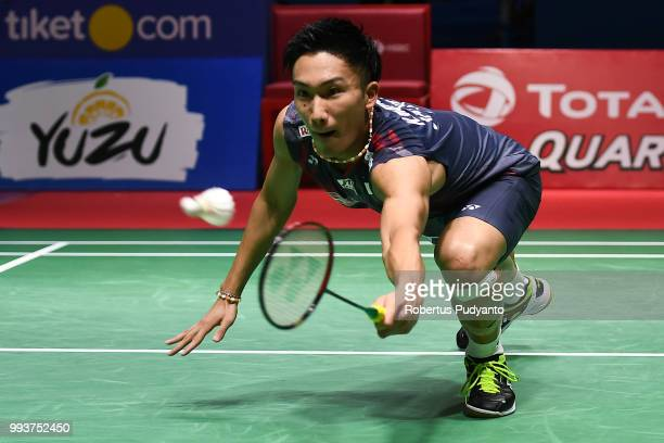 Kento Momota of Japan competes against Viktor Axelsen of Denmark during the Men's Singles Final match on day six of the Blibli Indonesia Open at...