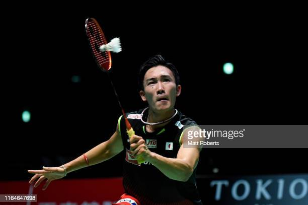 Kento Momota of Japan competes in the Men's Singles Final against Jonatan Christie of Indonesia on day six of the Daihatsu Yonex Japan Open Badminton...