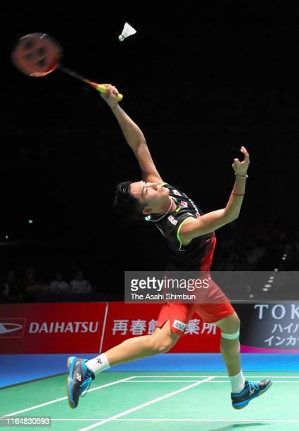 Kento Momota of Japan competes in the Men's Singles Final against Jonatan Christie of Indonesia on day six of the Daihatsu Yonex Japan Open Badminton...