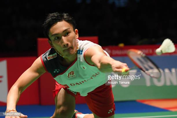 Kento Momota of Japan competes in the men's singles final match against Khosit Phetpradab of Thailand on day six of the Yonex Japan Open at Musashino...