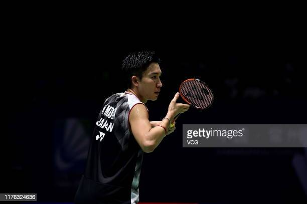 Kento Momota of Japan competes in the Men's Singles final match against Anthony Sinisuka Ginting of Indonesia on day six of 2019 China Badminton Open...