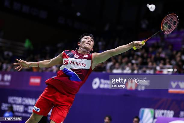 Kento Momota of Japan competes in the Men's Singles first round match against Lin Dan of China on day one of the China Open at Olympic Sports Center...