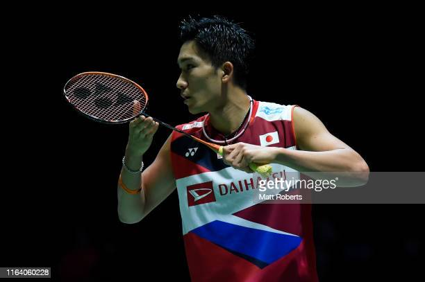 Kento Momota of Japan competes in the men's singles match against Kantaphon Wangcharoen of Thailand on day three of the Daihatsu Yonex Japan Open...