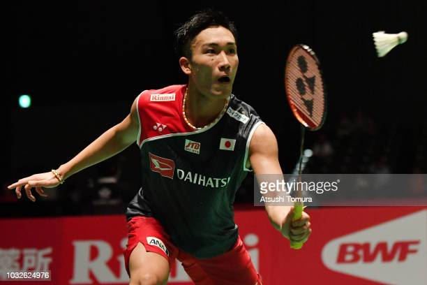 Kento Momota of Japan competes in the Men's Singles second round match against Rasmus Gemke of Denmark on day three of the Yonex Japan Open at...