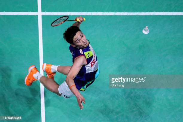 Kento Momota of Japan competes in the Men's Singles second round match against Kantaphon Wangcharoen of Thailand on day two of the Yonex All England...