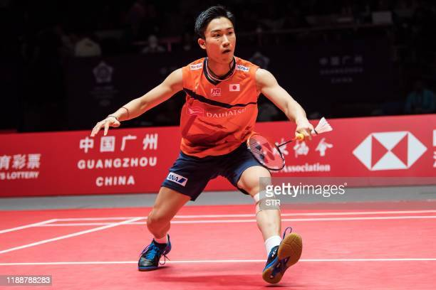 Kento Momota of Japan hits a return against Anthony Sinisuka Ginting of Indonesia during their men's singles final match at the BWF World Tour Finals...