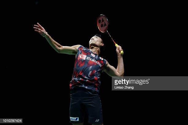 Kento Momota of Japan hits a return against B Sai Praneeth of India during their men's single quarter final match during the Badminton World...